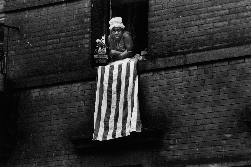 Untitled  (Woman with flag), 1961-1965 Silver Gelatin Print 11 x 14 inches