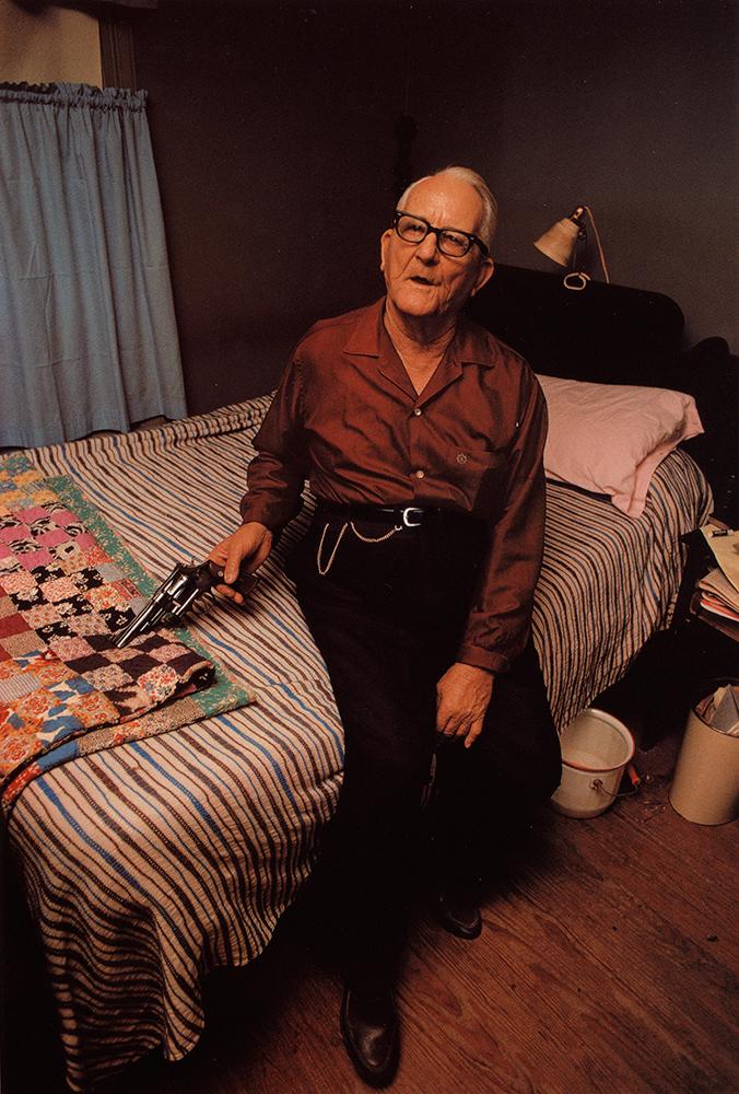 William Eggleston   Morton, Mississippi (Man on bed with gun), 1969-1970