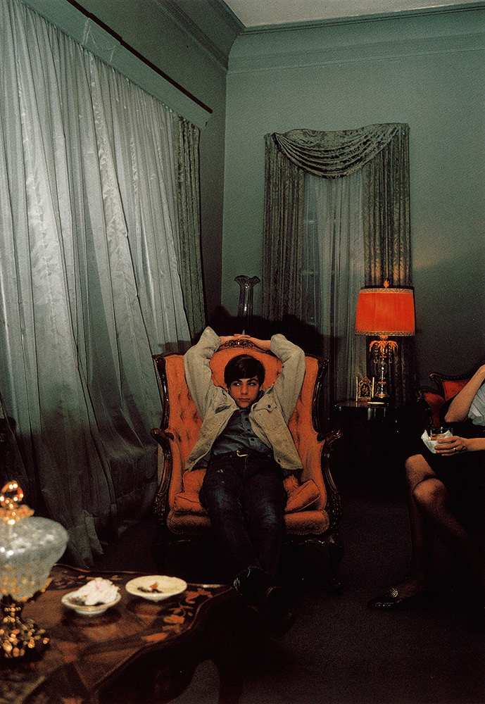 William Eggleston   Sumner, Mississippi (Young man in chair),circa 1970
