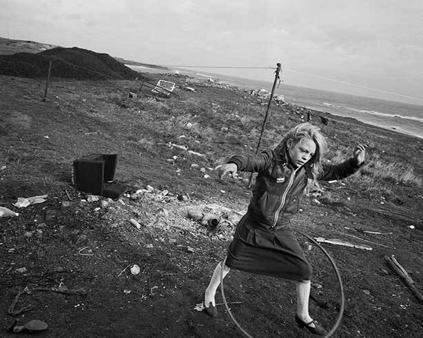 Chris Killip,  Helen and her hoola-hoop, Seacoal Camp, Lynemouth, Northumbria,  1984