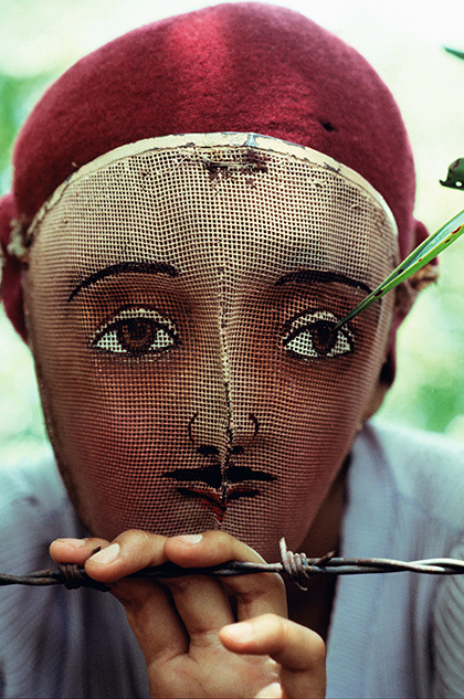 Photo: Nicaragua, 1978,Traditional Indian dance mask from the town of Monimbo, adopted by the rebels during the fight against Somoza to conceal identify  © Susan Meiselas / Magnum Photos