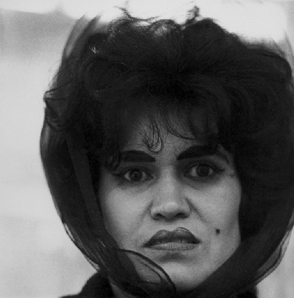 Diane Arbus  Puerto Rican Woman with a Beauty Mark , NYC, 1965 20 x 16 inches Silver Gelatin Print