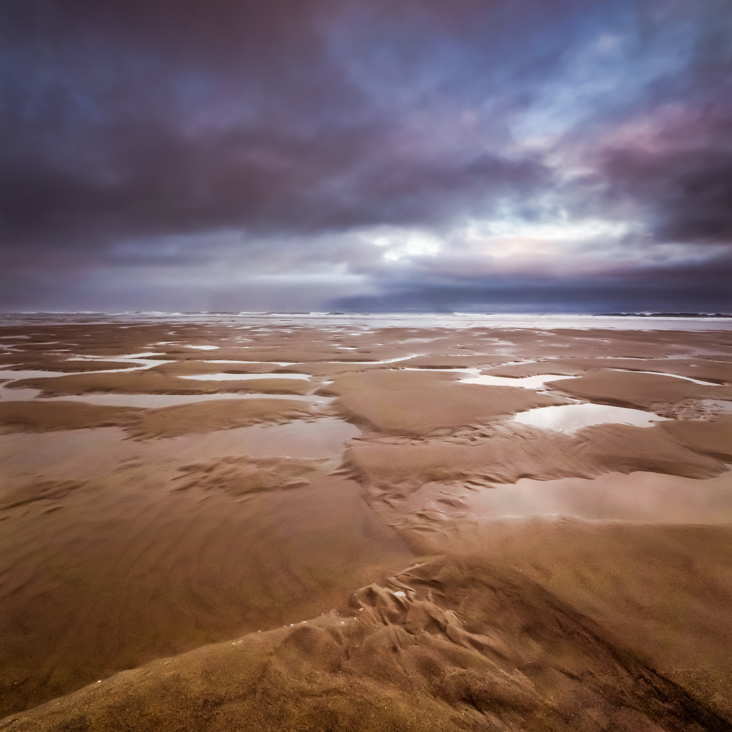 Low Tide - 12x12 print in a 16x16 mat  Taken on July 6, 2015 in Lincoln City, Oregon.  This photo was taken with a tilt shift lens and is actually three photos stitched together.  First shown at the Denver Art Society - November 2016 First Friday.