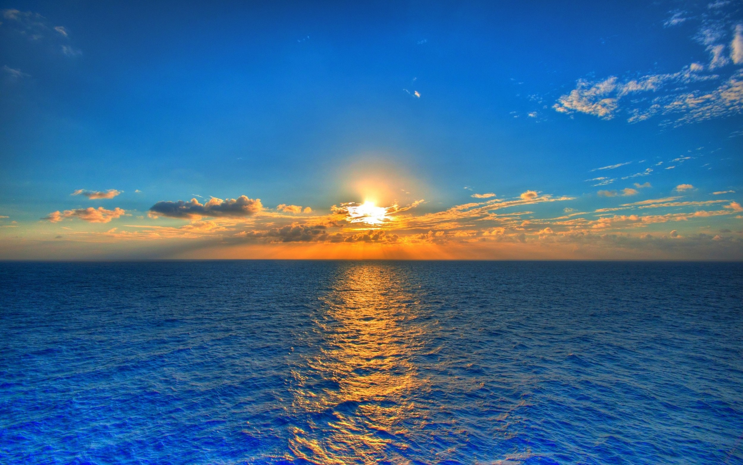 sunset on blue sea water.jpg