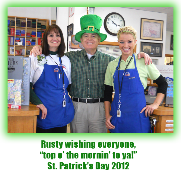 Southgate Coins owners Rusty and Marie Goe and employee Nicole Hoff enjoy St. Patrick's Day at the Reno coin shop