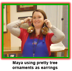 Southgate Coins Manager Maya Jones plays with ornaments while buying and selling gold and silver.