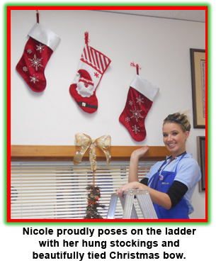 Southgate Coins employee Nicole Hoff hangs stockings at the Reno coin and bullion shop