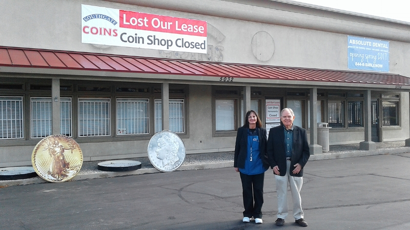 Southgate Coins owners Rusty and Marie Goe stand in front of their closed coin shop November 1, 2016
