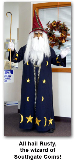 Southgate Coins owner Rusty Goe dresses as a wizard for Halloween 2011