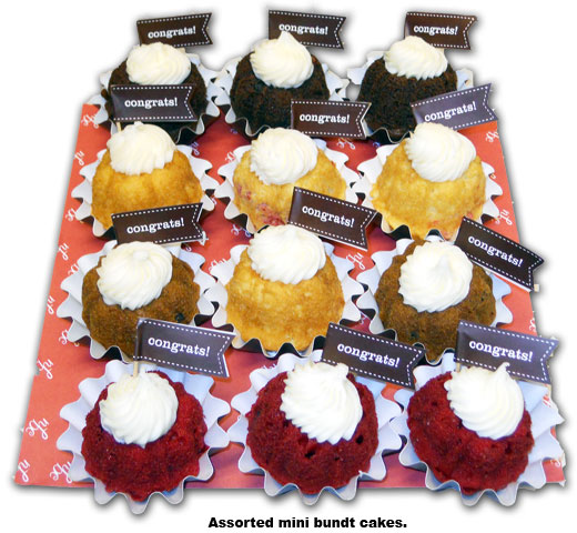Southgate Coins employee Nicole Hoff receives mini-bundt cakes for her 2 year anniversary