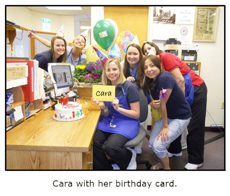 Cara displays the birthday card she received from her Southgate coins coworkers