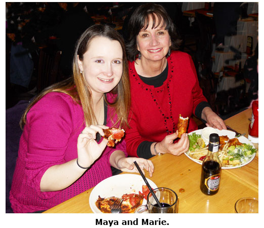Southgate Coins owner Marie Goe poses with employee Maya at BJs Christmas dinner