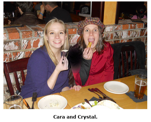 Southgate Coins staffers Crystal and Cara stuff their face during the Christmas dinner