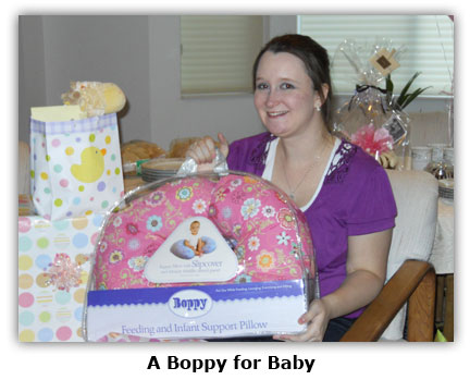 Maya receives a boppy for her coin shop baby girl