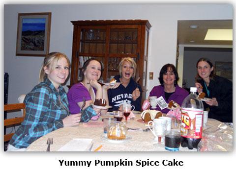 Southgate Coins employees enjoy pumpkin spice cake at Maya's surprise baby shower