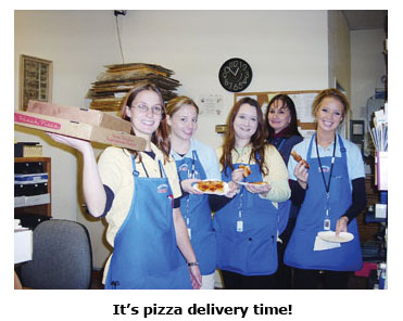 The crew at Southgate enjoys a pizza for Free Lunch Friday