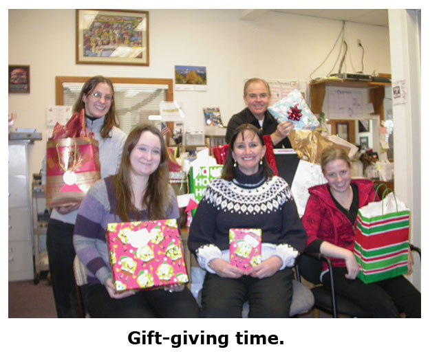Southgate Coins staff exchanges gifts on Christmas