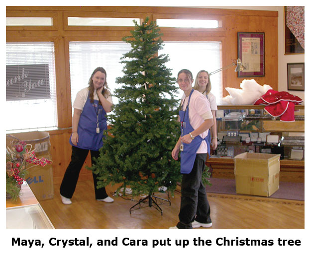 Southgate Coins crew decorates the Christmas tree