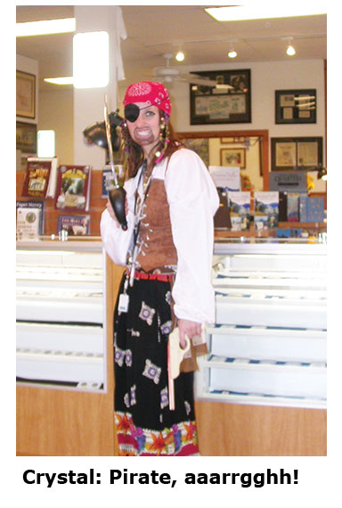 Crystal becomes a pirate at the coin shop's Halloween dress up day