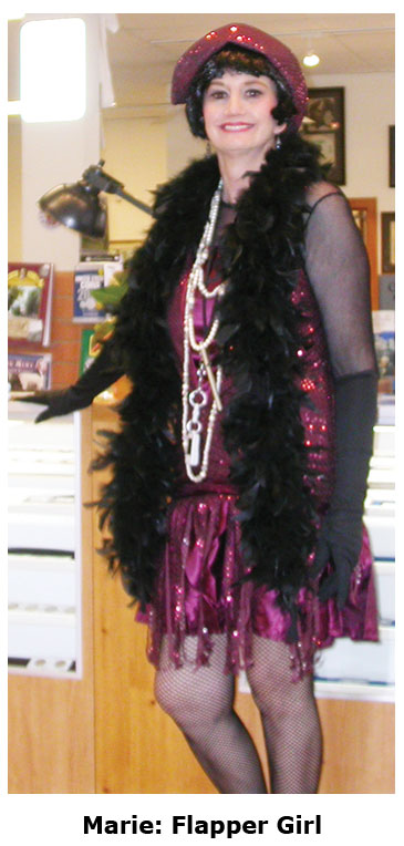 Southgate Coins owner Marie Goe dresses as a flapper on Halloween