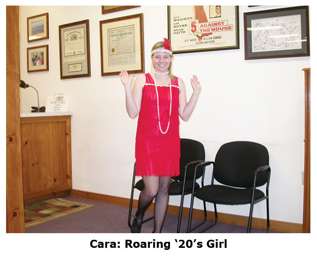 Cara's a roaring 20s flapper at the coin shops Halloween dress up day