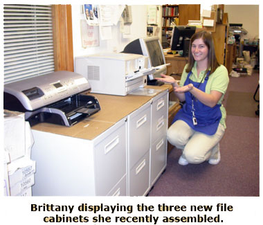 Britanny showing off her newly assembled file cabinets