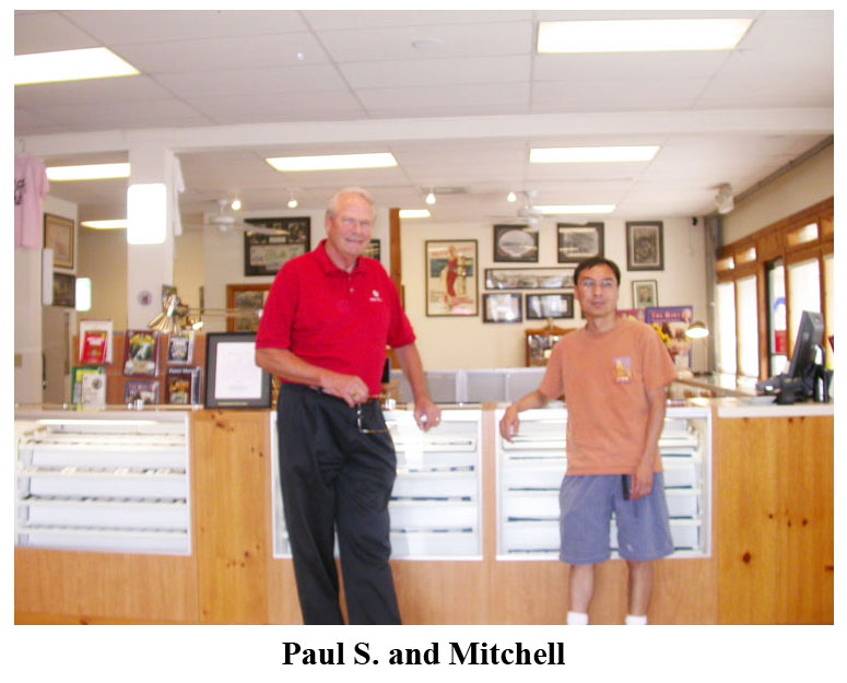 C4OA Treasurer Paul Sudmeier and club member Mitchell Yee visit the coin shop