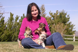 Southgate Coins owner Marie Goe welcomes puppy Lillie into the family