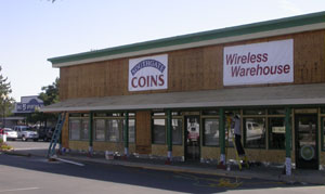 Southgate Coins is stripped of its fascia during the renovation