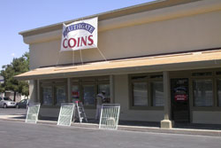 The paint is on the walls at the coin shop