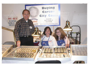 Southgate Coins owners Rusty and Marie Goe pose with employee Amy at the coin show