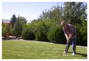 Southgate Coins owner Rusty Goe plays croquet on the lawn