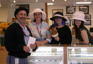 Brian the Mailman poses with a bowler hat on Kentucky Derby Day at the coin shop