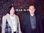 Southgate Coins owners Rusty and Marie posing at the steakhouse