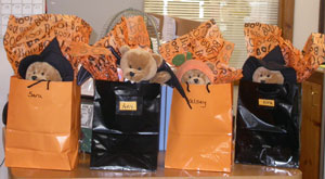 Marie gifts the employees Halloween goody bags with stuffed animals