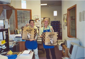 Southgate employees retrieving traditional Free Lunch Friday food