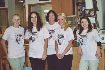 Southgate Coins staffers in their Flipping is Sweet company T-shirts