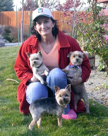 Southgate Coins owner Marie poses with the pups