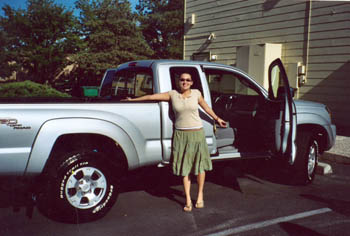 Southgate Coins employee Somer gets her brand new silver truck