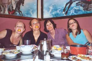 Marie and the Southgate Girls make silly faces at dinner in San Francisco