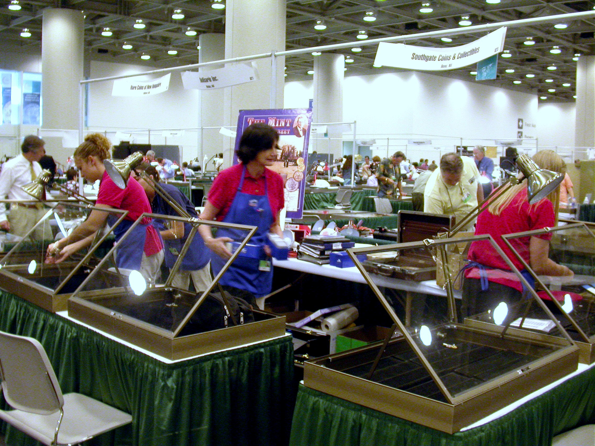Southgate Coins owner Marie and her employees set up the booth at the 2005 Summer ANA