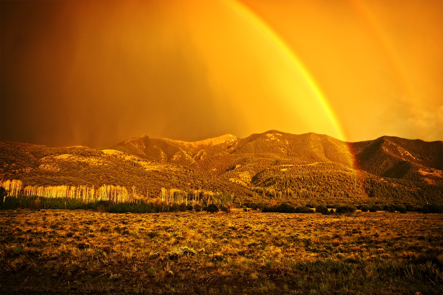 Sunset rainbow outside of Great Sand Dunes National Park, near Alamosa, Colorado. Processed using On1 Effects.