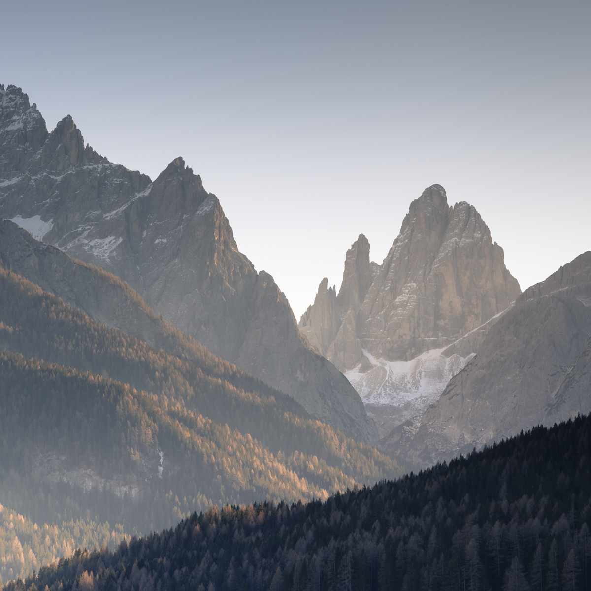 Late afternoon Sun dipping below the sharp peaks often provides great photographic opportunities.