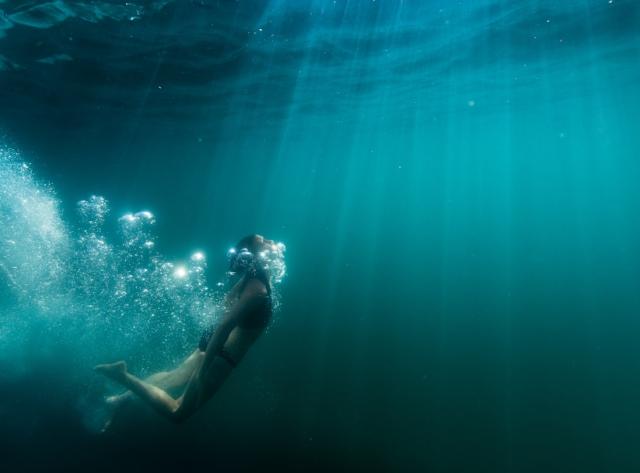 Diving Deep in Elk Lake, Oregon, photo by Tyler Roemer