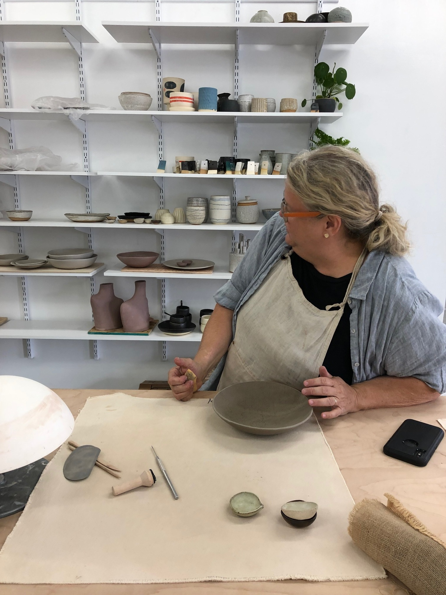 Marité making the final details on a bowl inside her new workspace in Tumalo, Oregon called The Studio: Pottery + Arts Collective.