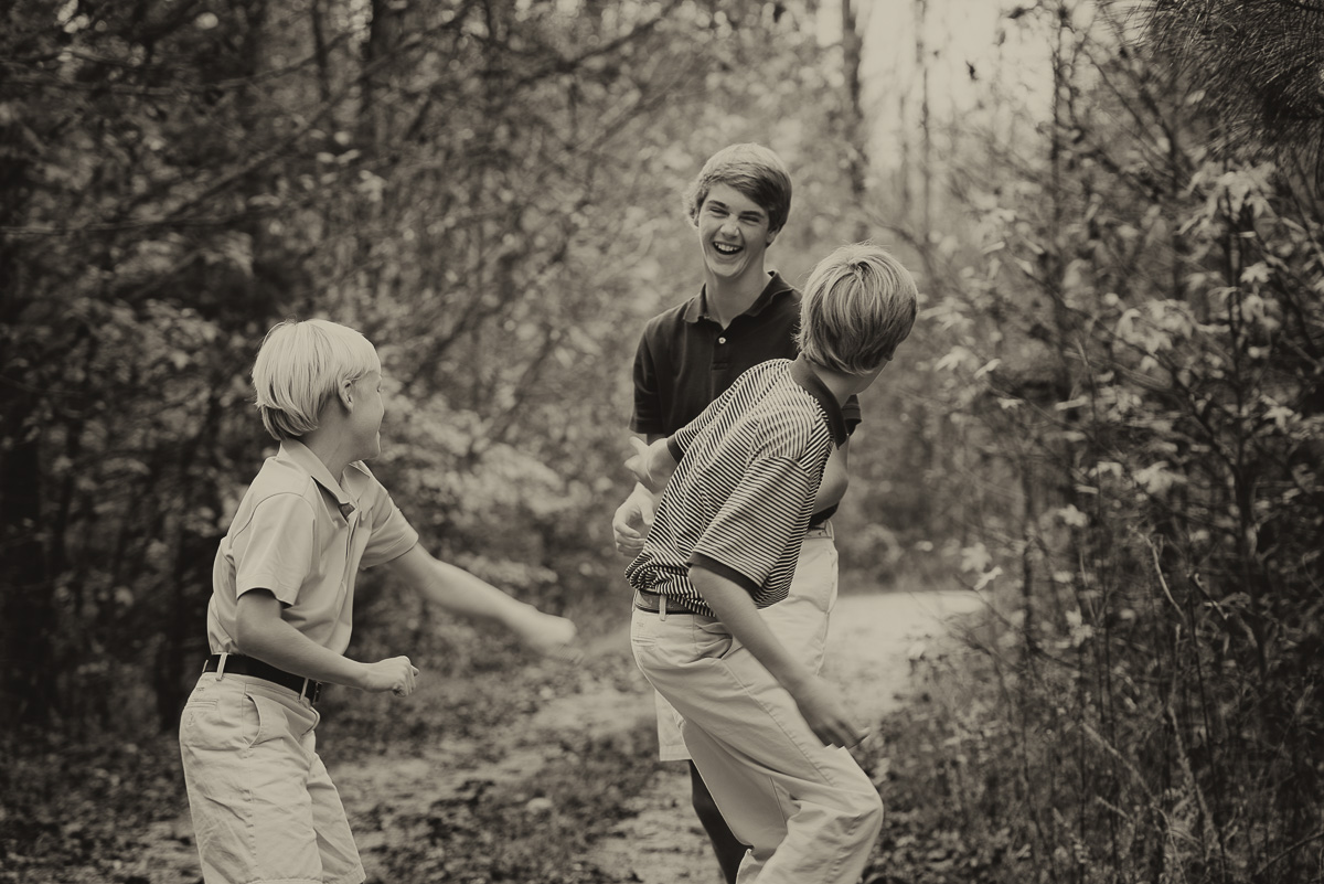 my favorite image from our session... the taunting big brother gets ganged up on!
