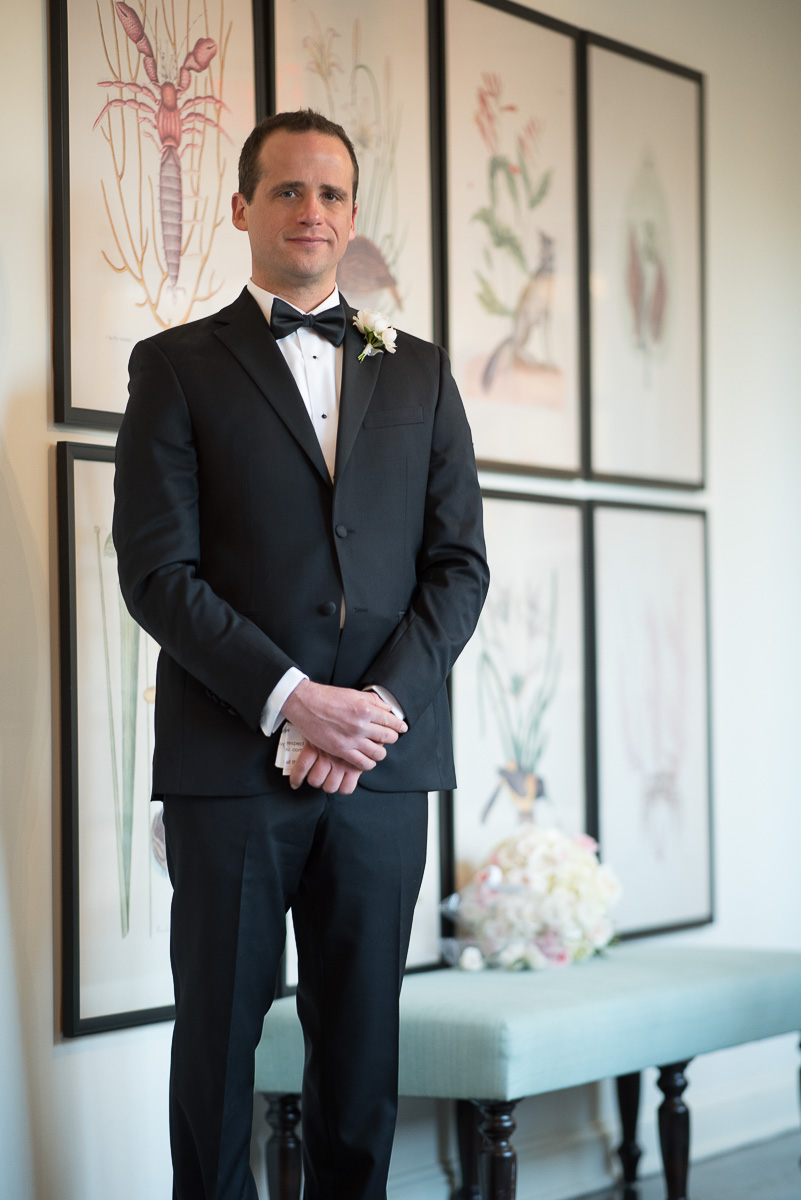 This loving, emotional groom holds his vows and chokes back tears before he walks down the aisle to wait for his bride....