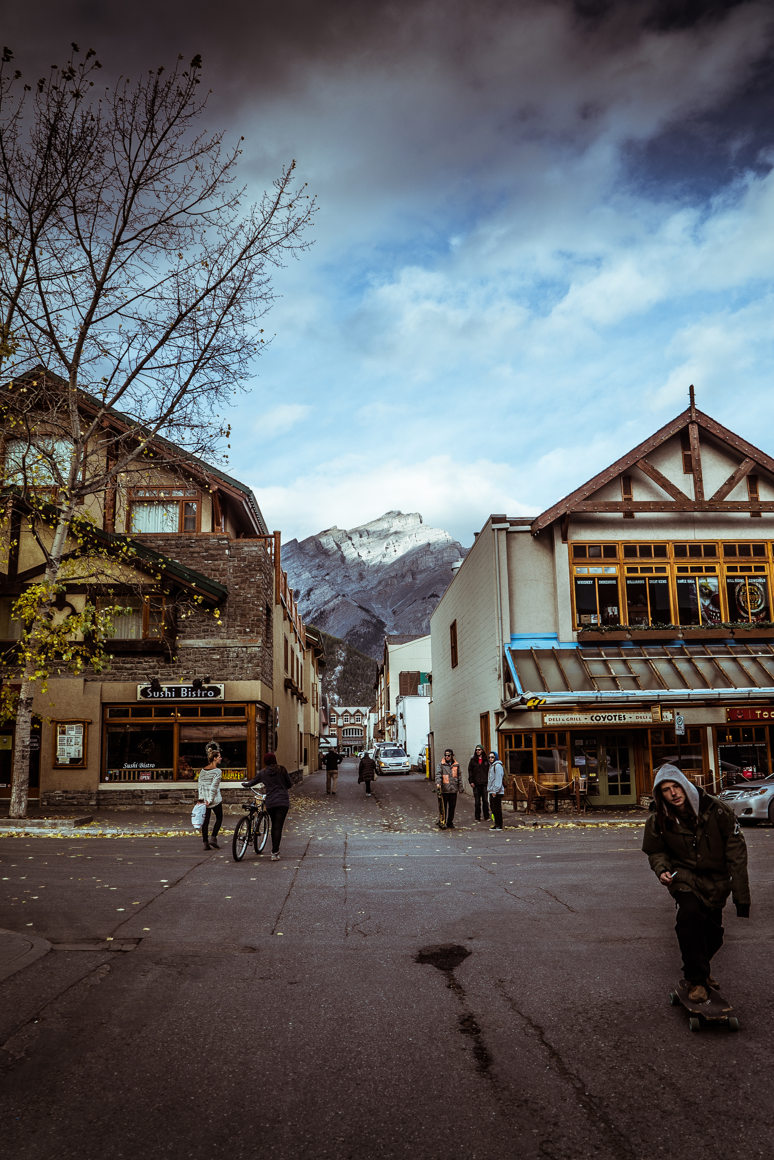 In a back alley in Banff. With Cascade Mountain