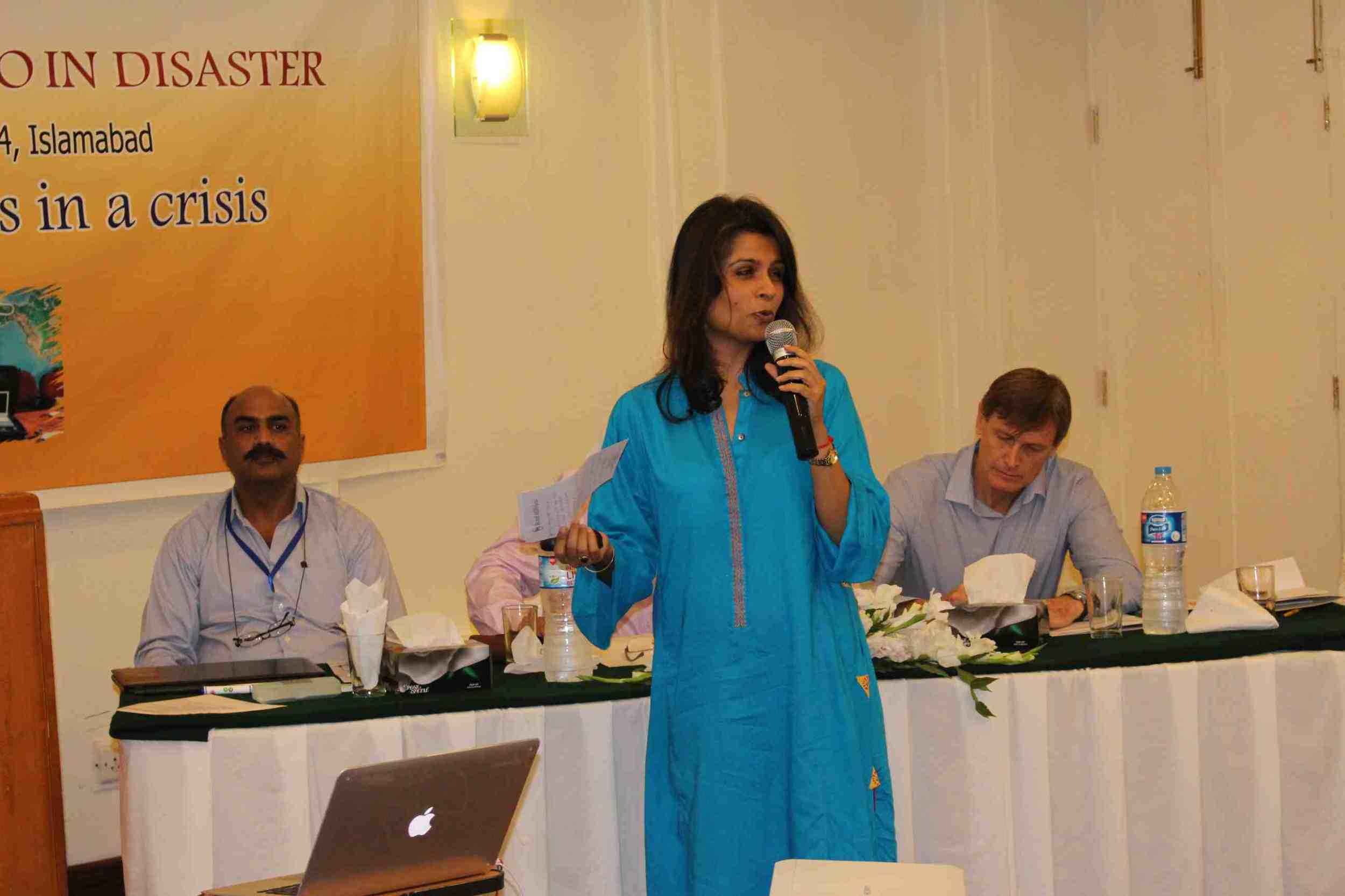 IOM's Naima Saeed speaking at the First Response Radio inaugural event in Islamabad