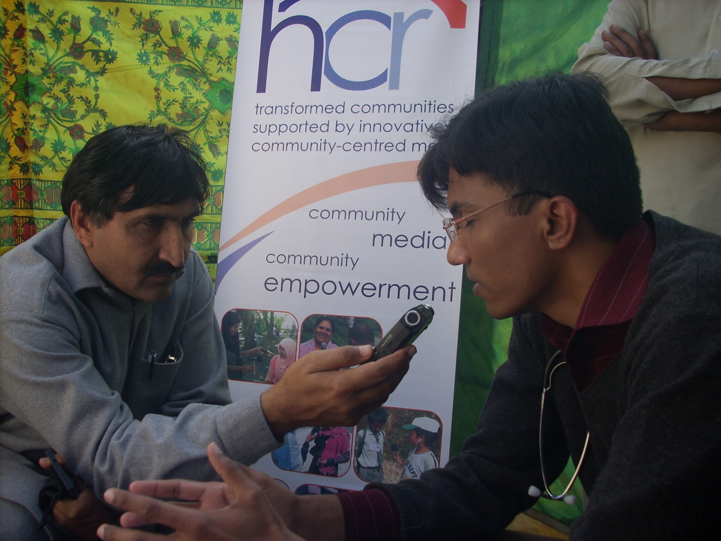 A journalist interviews one of the doctors during the camp for broadcast on local radio